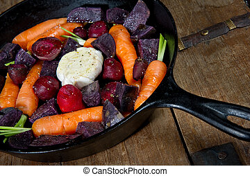 Cast Iron Skillet with raw vegetables - Raw root vegetables...