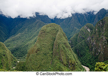 View from Machu Picchu to the Putucusi Happy Mountain, just...
