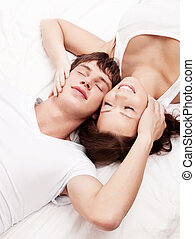 couple in bed - happy young beautiful couple in bed at home,...