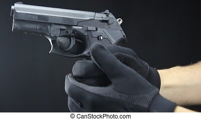 shooting handgun - handgun close up over black background