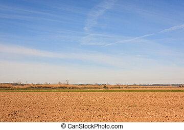 Blue sky over arid plain field on Portugal