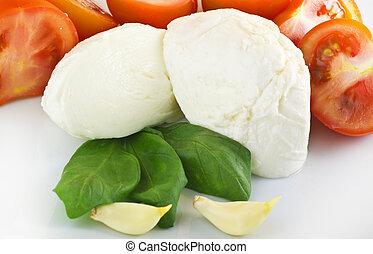 mozzarella tomato and basil  on white