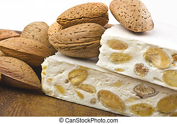 Nougat with almonds on the wood