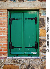 Window with wooden painted green shutters