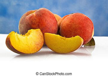 fresh peach fruits with cut