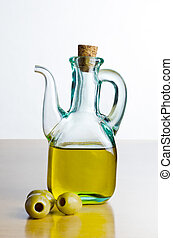 Jug of Olive Oil with Olives - A corked glass jug of olive...