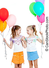 Two girls  with colorful ballons in hands. Isolated on white.