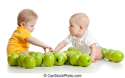 Two little children with green apples isolated on white background