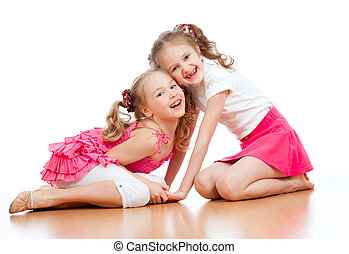 Two girls are playing together Isolated over white...