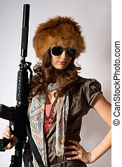 Young stylish woman with a gun