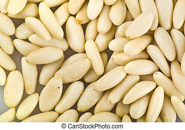 Pine nuts background, food texture.