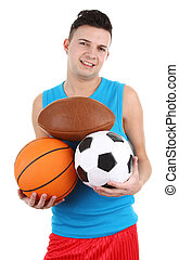 Guy holding different sports balls - A guy holding different...