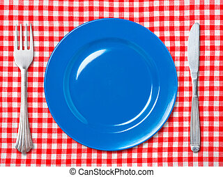Blue dinner plate with fork and knife - Empty blue dinner...