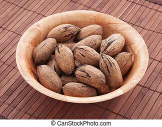 Pecan nuts. - Bowl of pecan nuts, close up shot.