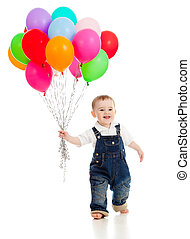Smiling baby boy  with bunch of colorful ballons in his hand. Isolated on white.
