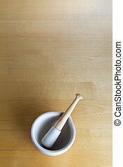 Pestle and Mortar on Wood - overhead shot of a pestle and...