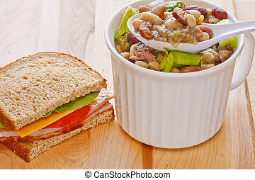 Bean Soup and Half Ham Sandwich - A half ham sandwich with a...