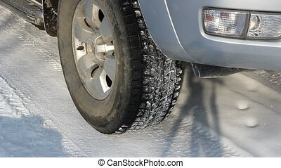 Wheels of a car traveling on winter roads HD H264