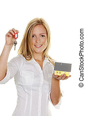 a young woman with a model house and apartment keys.