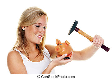 a young woman kills her piggybank with a hammer.
