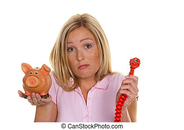 a young woman holding a piggy bank and a power plug photo...