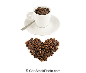 Roasted coffee beans in the shape of the heart.