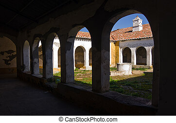 Ruin Cloister - Cloister with arches in the ruin of an old...