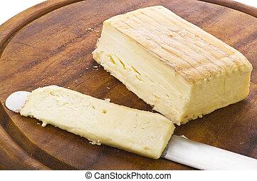 Taleggio cheese cut on knife