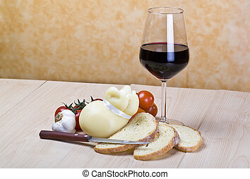 Scamorza cheese and sliced bread on wood