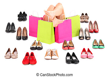Shoe shopping - A picture of sexy female legs among shoes...