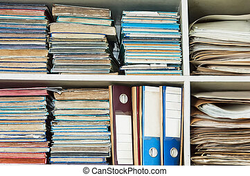 Old Office Files - Stack of old logbooks and folders in open...