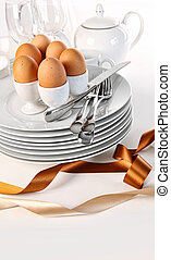 Brown eggs with plates for Easter breakfast