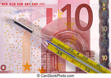 medical thermometer on euro banknote