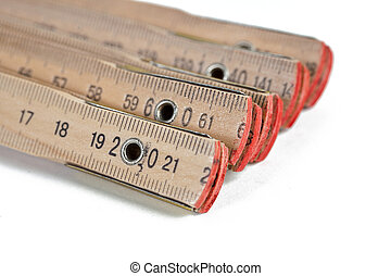 A wooden ruler on a white background. Taken in Studio with a...