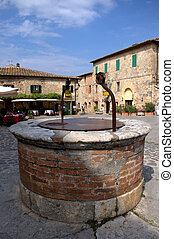 Medieval Cistern - stone cistern in the Medieval Italian...
