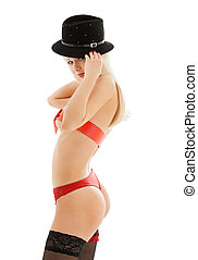 playful girl in red belt and black hat