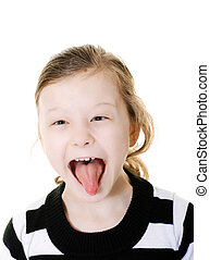 girl sticking her tongue out - young girl sticking her...
