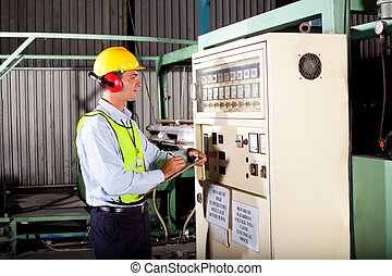 industrial technician - male industrial technician writing...