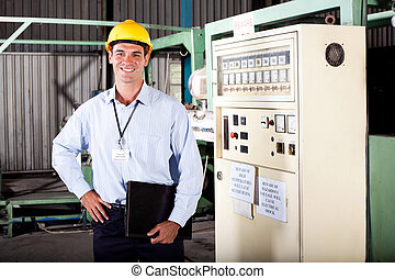 male industrial engineer portrait in factory