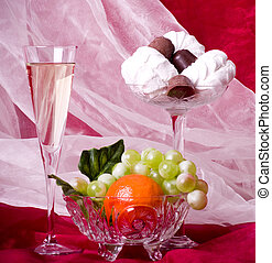 fruits, chocolate and wine on vase - composition with...