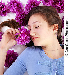 Teenager and flowers - Teenager with eyes closes surrounded...