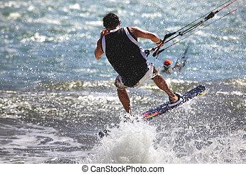Kiteboarder enjoy surfing in ocean. Vietnam