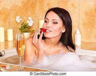 Woman relaxing in bath. - Woman washing in  bubble bath.