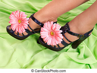 Female feet with flower. Spring concept.
