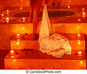 Woman relaxing in bath. - Woman in bath tub. Low section.