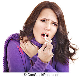 Woman using throat spray - Young woman using throat spray...