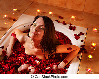 Woman relaxing in bath. - Woman swimming of bath tub.