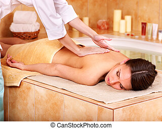 Massage of woman in beauty spa - Young woman in hammam or...