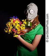 Young woman  in gas mask and flowers .Toxic Environment