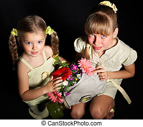 Little girl holding flowers
